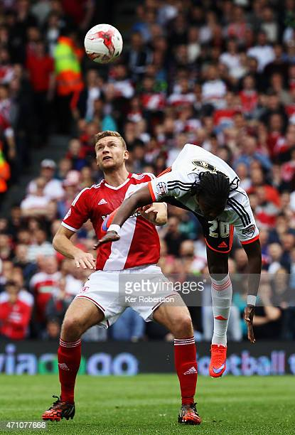 Ben Gibson of Middlesbrough and Hugo Rodallega of Fulham challenge for the ball during the Sky Bet Championship match between Fulham and...