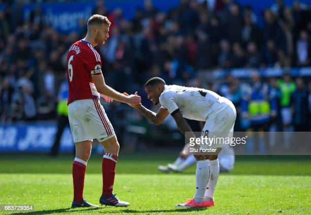 Ben Gibson of Middlesbrough and Luciano Narsingh of Swansea City shake hands after the Premier League match between Swansea City and Middlesbrough at...