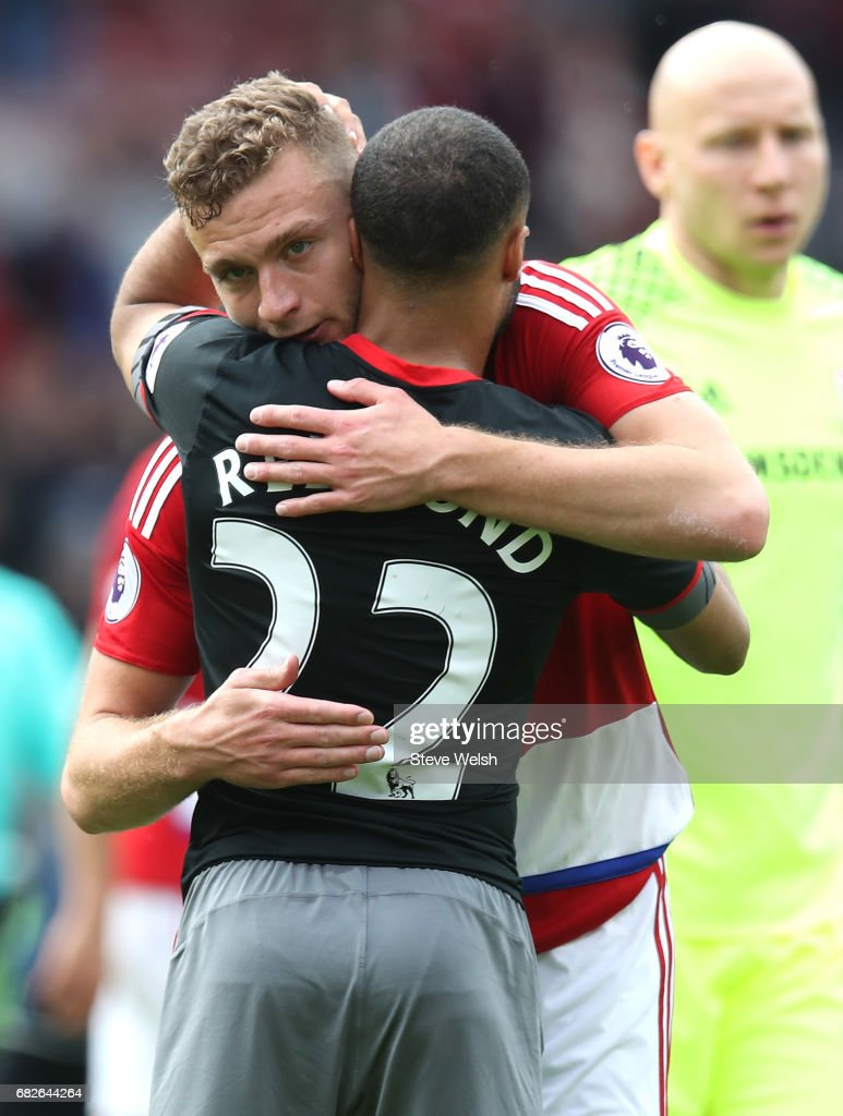 Ben Gibson of Middlesbrough and Nathan Redmond of Southampton embrace after the Premier League match between Middlesbrough and Southampton at Riverside Stadium on May 13, 2017 in Middlesbrough, England.