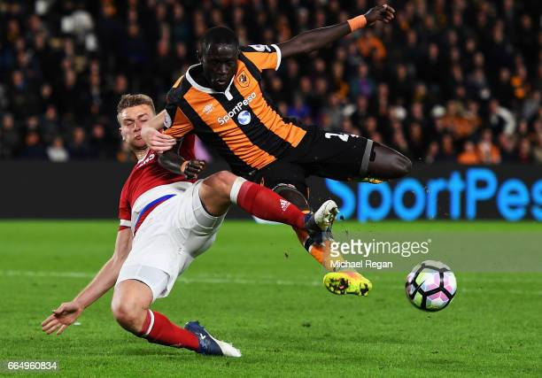 Ben Gibson of Middlesbrough and Oumar Niasse of Hull City battle for possession during the Premier League match between Hull City and Middlesbrough...