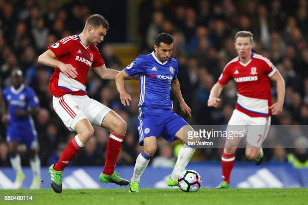 Ben Gibson of Middlesbrough closes down Pedro of Chelsea during the Premier League match between Chelsea and Middlesbrough at Stamford Bridge on May...