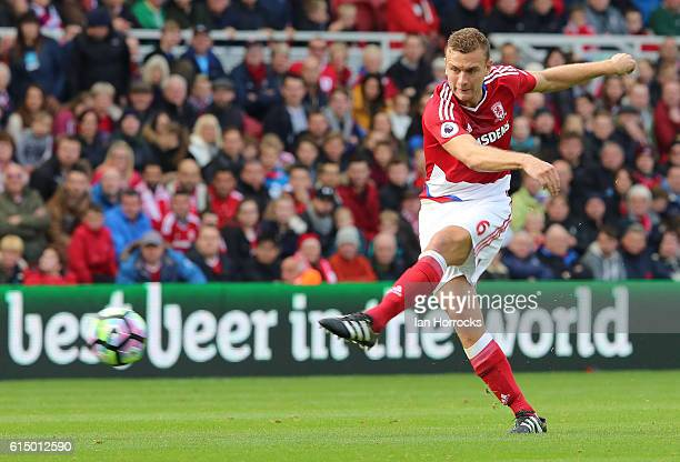 Ben Gibson of Middlesbrough has a shot during the Premier League match between Middlesbrough and Watford at the Riverside Stadium stadium on October...