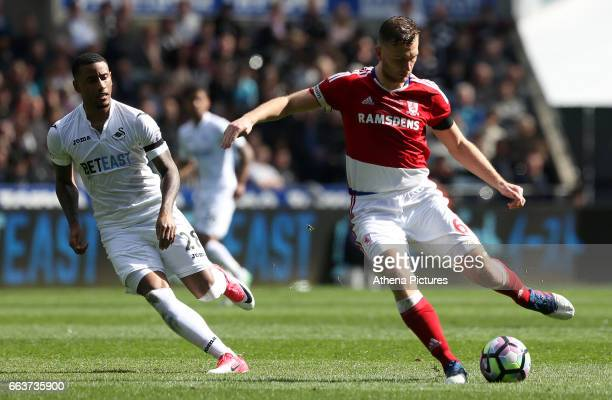 Ben Gibson of Middlesbrough is closely marked by Luciano Narsingh of Swansea City during the Premier League match between Swansea City and...