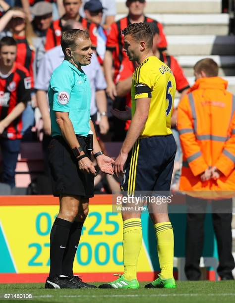 Ben Gibson of Middlesbrough protests the red card of Gaston Ramirez of Middlesbrough during the Premier League match between AFC Bournemouth and...