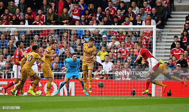 Ben Gibson of Middlesbrough scores his sides first goal during the Premier League match between Middlesbrough and Tottenham Hotspur at the Riverside...