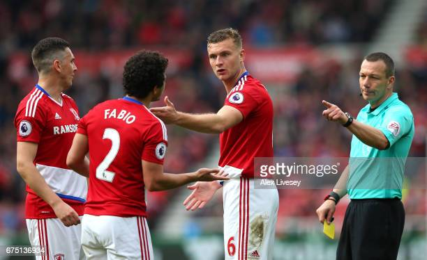 Ben Gibson of Middlesbrough speaks to Fabio Da Silva of Middlesbrough and Stewart Downing of Middlesbrough during the Premier League match between...