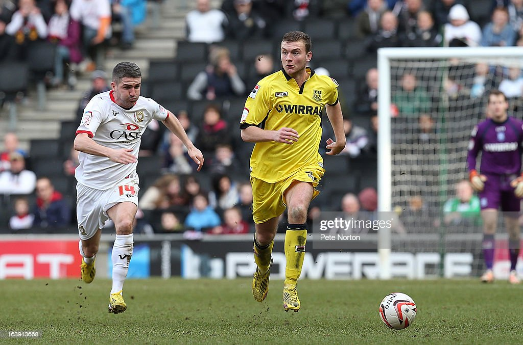 Ben Gibson of Tranmere Rovers moves forward the ball away from Ryan Lowe of MK Dons during the npower League One match between MK Dons and Tranmere Rovers at Stadium MK on March 16, 2013 in Milton Keynes, England.