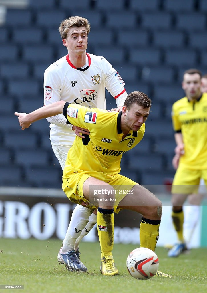 Ben Gibson of Tranmere Rovers shields the ball under pressure from Patrick Bamford of MK Dons during the npower League One match between MK Dons and Tranmere Rovers at Stadium MK on March 16, 2013 in Milton Keynes, England.