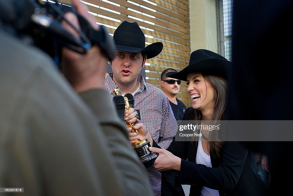 Ben Gleip and Angela Greenup speak with the media with an Oscar trophey during First-Ever Oscar Roadtrip at the Angelika Film Center on February 18, 2013 in Dallas.