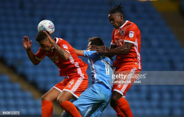 Ben Godfrey and Omar Beckles of Shrewsbury Town beat Tony Andreu of Coventry City during the EFL Checkatrade Trophy match between Coventry City v...