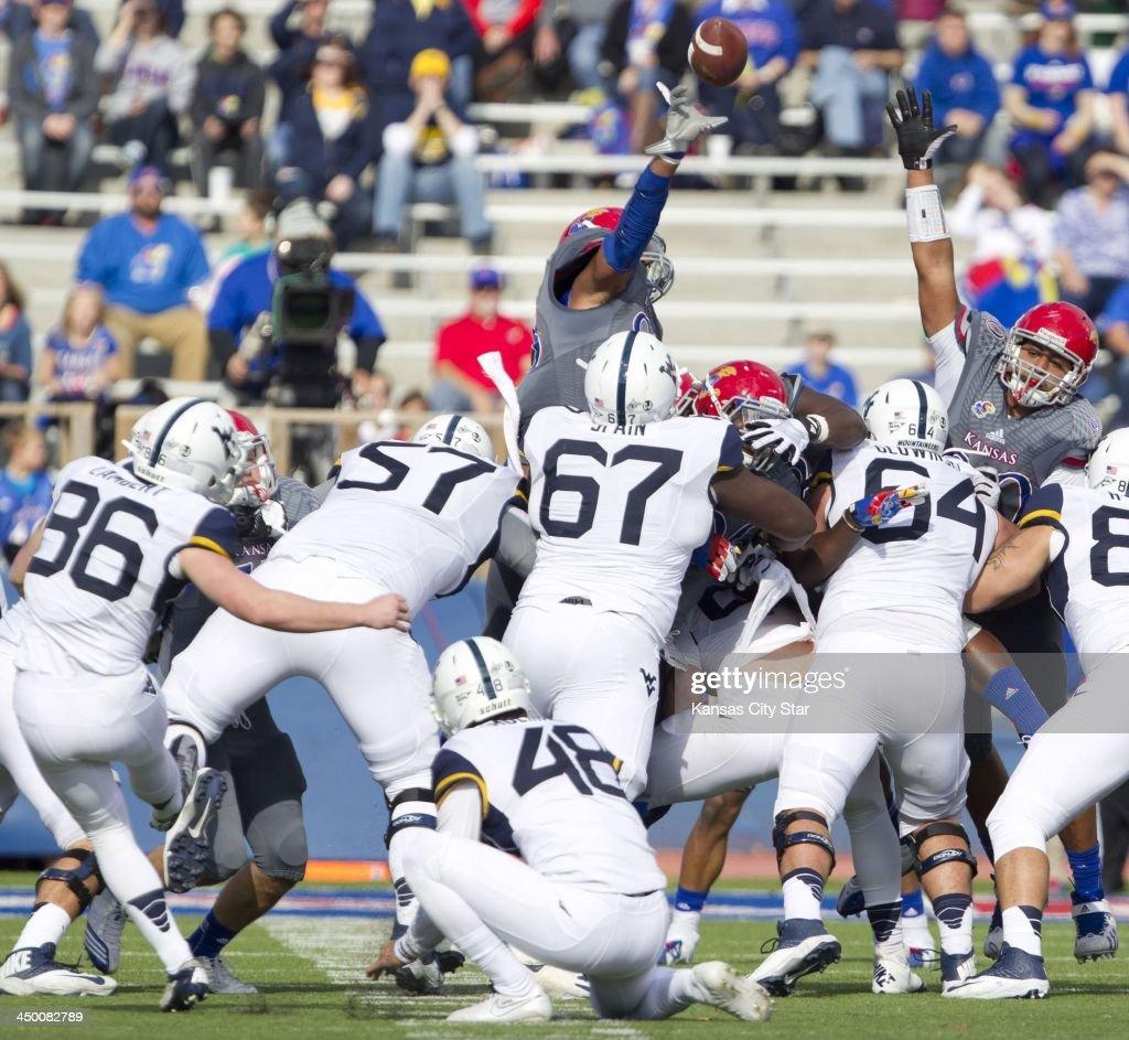 Ben Goodman (93) of Kansas blocks a field goal attempt by Kicker Josh Lambert (86) of West Virginia during the first half. The Kansas Jayhawks defeated the West Virginia Mountaineers, 31-19, at Memorial Stadium in Lawrence, Kansas, on Saturday, Nov. 16, 2013.
