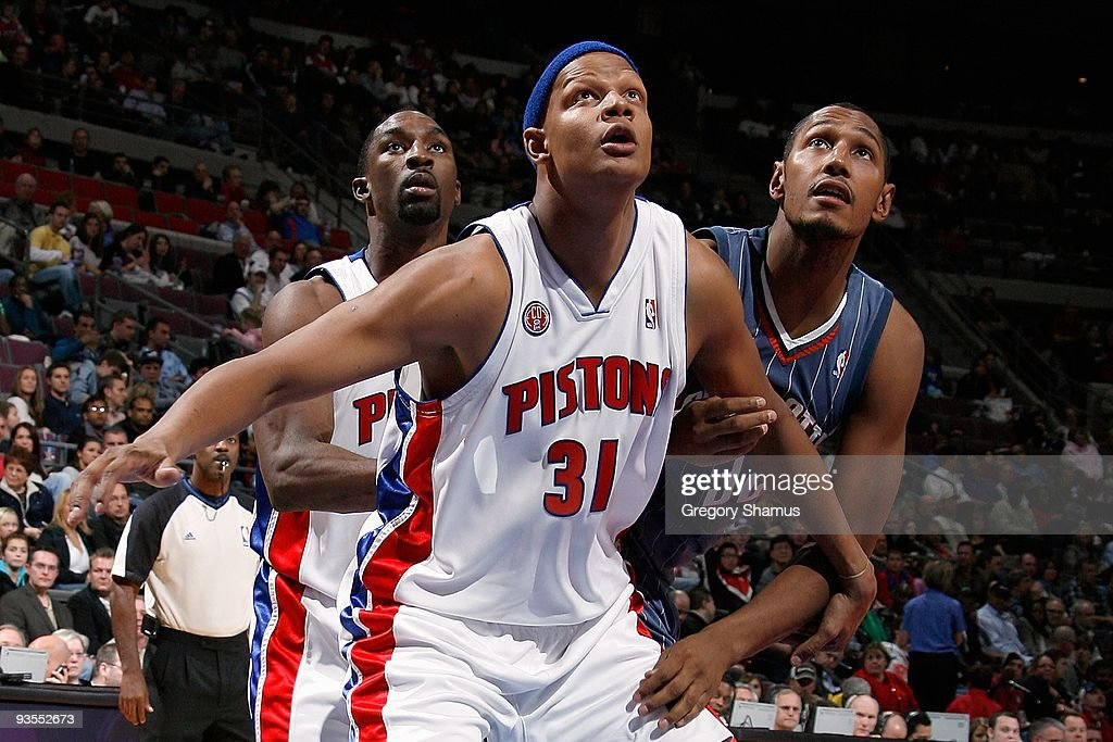 Ben Gordon and Charlie Villanueva of the Detroit Pistons look for the rebound against Boris Diaw of the Charlotte Bobcats during the game on November...