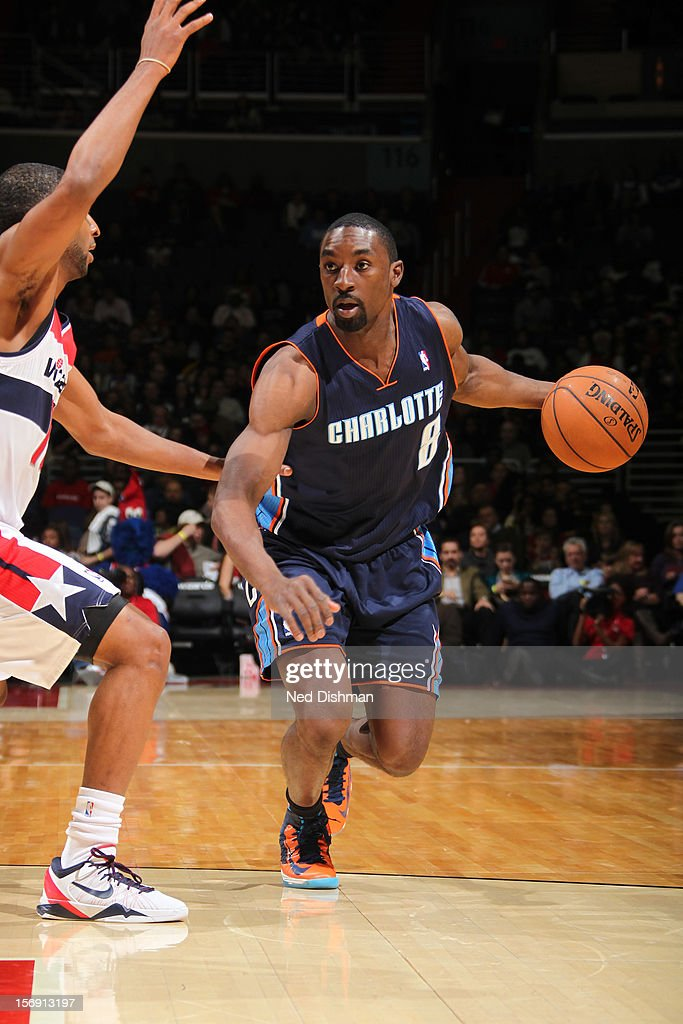 <a gi-track='captionPersonalityLinkClicked' href=/galleries/search?phrase=Ben+Gordon&family=editorial&specificpeople=202181 ng-click='$event.stopPropagation()'>Ben Gordon</a> #8 of the Charlotte Bobcats drives against A.J. Price #12 of the Washington Wizards during the game at the Verizon Center on November 24, 2012 in Washington, DC.