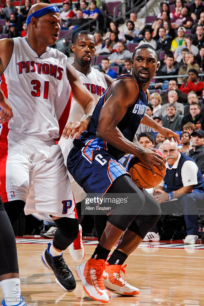 Ben Gordon #8 of the Charlotte Bobcats drives against Charlie Villanueva #31 and Rodney Stuckey #3 of the Detroit Pistons on January 6, 2013 at The Palace of Auburn Hills in Auburn Hills, Michigan.