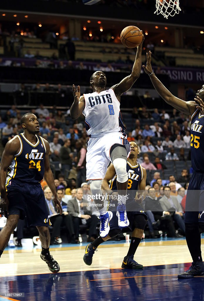 Ben Gordon #8 of the Charlotte Bobcats drives to the basket against Al Jefferson #25 of the Utah Jazz during their game at Time Warner Cable Arena on January 9, 2013 in Charlotte, North Carolina.