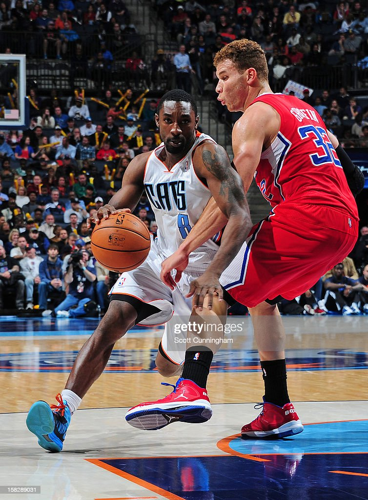 Ben Gordon #8 of the Charlotte Bobcats drives to the basket against Blake Griffin #32 of the Los Angeles Clippers at Time Warner Cable Arena on December 12, 2012 in Charlotte, North Carolina.