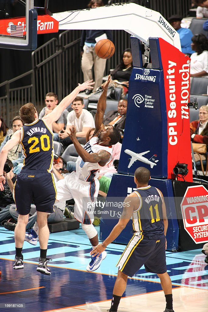 Ben Gordon #8 of the Charlotte Bobcats drives to the basket against Gordon Hayward #20 of the Utah Jazz at the Time Warner Cable Arena on January 9, 2013 in Charlotte, North Carolina.