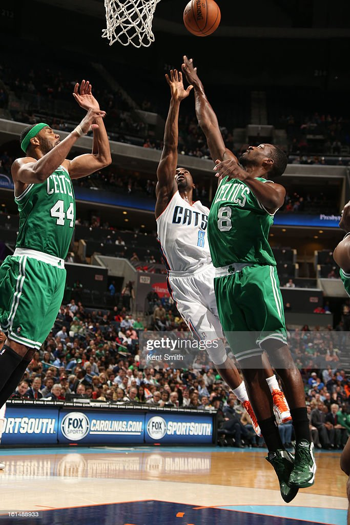 Ben Gordon #8 of the Charlotte Bobcats goes for the rebound against Chris Wilcox #44 and Jeff Green #8 of the Boston Celtics at the Time Warner Cable Arena on February 11, 2013 in Charlotte, North Carolina.