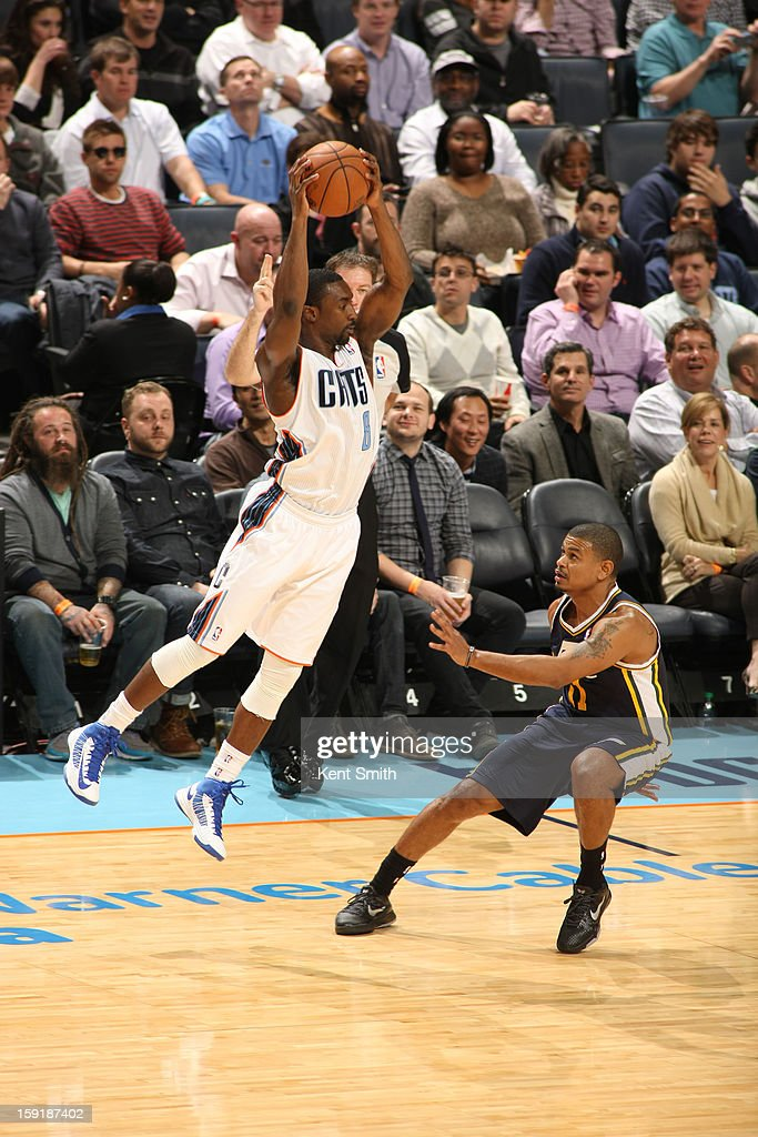 Ben Gordon #8 of the Charlotte Bobcats grabs a rebound over Earl Watson #11 of the Utah Jazz at the Time Warner Cable Arena on January 9, 2013 in Charlotte, North Carolina.