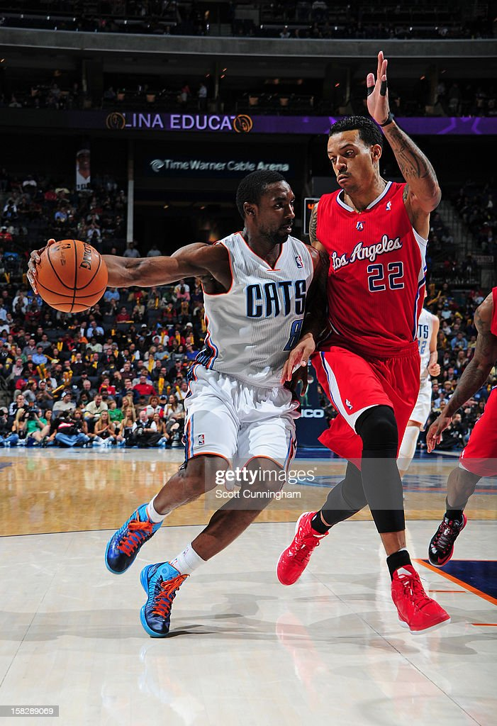 Ben Gordon #8 of the Charlotte Bobcats handles the ball against Matt Barnes #22 of the Los Angeles Clippers at Time Warner Cable Arena on December 12, 2012 in Charlotte, North Carolina.