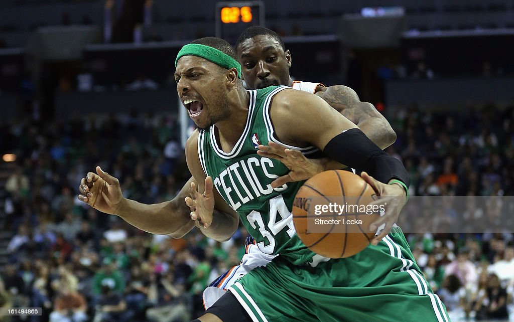 Ben Gordon of the Charlotte Bobcats reaches in for the ball against Paul Pierce of the Boston Celtics during their game at Time Warner Cable Arena on...