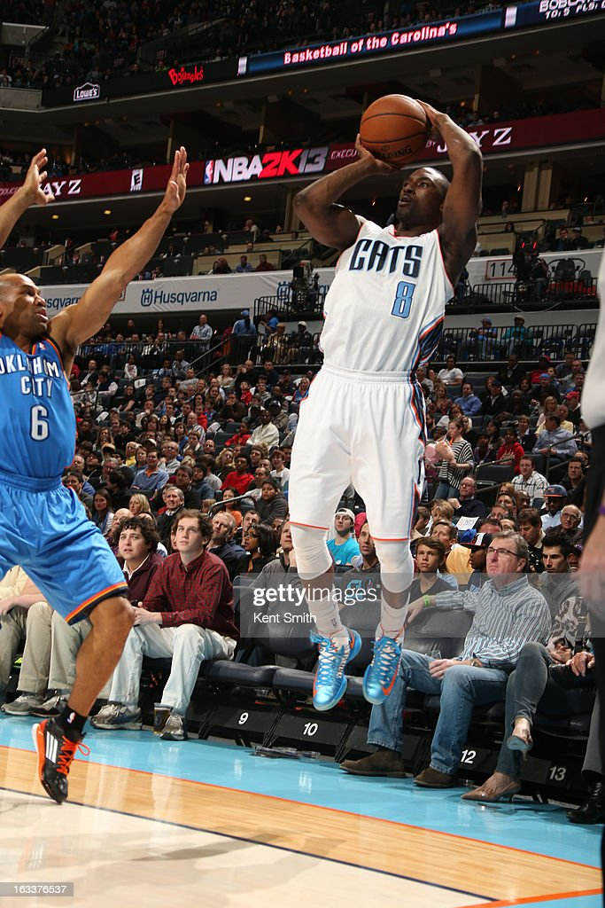 Ben Gordon #8 of the Charlotte Bobcats shoots against Derek Fisher #6 of the Oklahoma City Thunder at the Time Warner Cable Arena on March 8, 2013 in Charlotte, North Carolina.