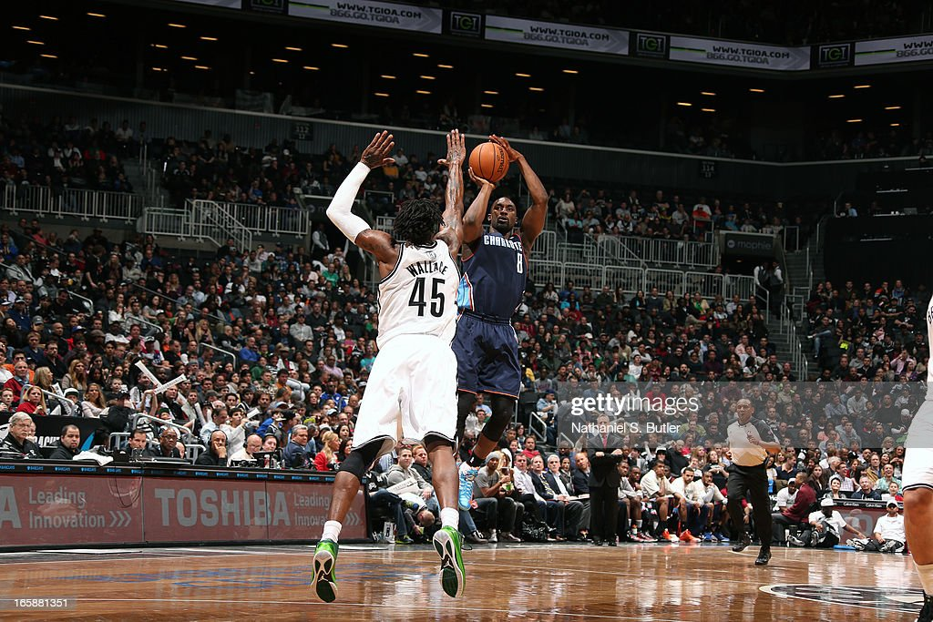 Ben Gordon #8 of the Charlotte Bobcats shoots against Gerald Wallace #45 of the Brooklyn Nets on April 6, 2013 at the Barclays Center in the Brooklyn borough of New York City.