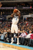 Ben Gordon of the Charlotte Bobcats shoots against the Milwaukee Bucks during the game at the Time Warner Cable Arena on December 23 2013 in...