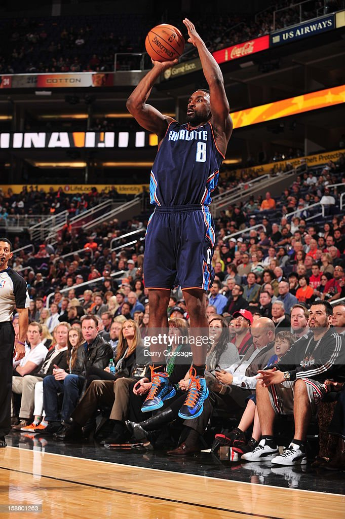 <a gi-track='captionPersonalityLinkClicked' href=/galleries/search?phrase=Ben+Gordon&family=editorial&specificpeople=202181 ng-click='$event.stopPropagation()'>Ben Gordon</a> #8 of the Charlotte Bobcats shoots the ball against the Phoenix Suns on December 19, 2012 at U.S. Airways Center in Phoenix, Arizona.
