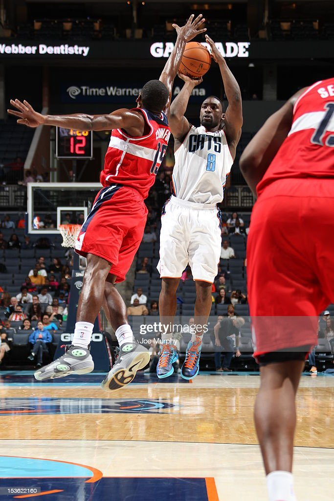 Ben Gordon #8 of the Charlotte Bobcats shoots the ball to the basket against Jordan Crawford #15 of the Washington Wizards during the game between the Charlotte Bobcats and the Washington Wizards at the Time Warner Cable Arena on October 7, 2012 in Charlotte, North Carolina.