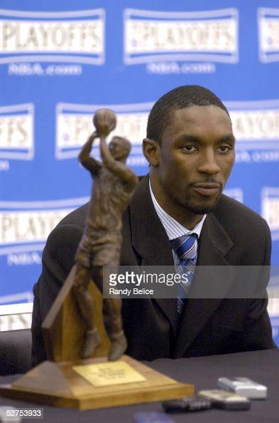 Ben Gordon of the Chicago Bulls listens to a reporter's question with the NBA Sixth Man of the Year Award trophy nearby during a press conference at...