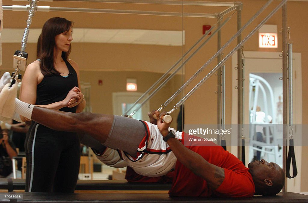 Ben Gordon of the Chicago Bulls performs a resistance based exercise under the eye of his trainer during a workout on September 20, 2006 at the Chicago Bulls' practice facility in Chicago, Illinois.
