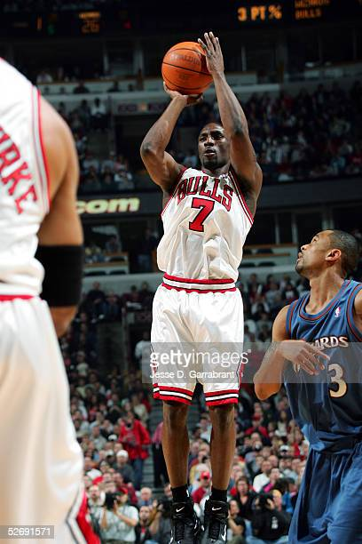 Ben Gordon of the Chicago Bulls shoots past Juan Dixon of the Washington Wizards in Game one of the Western Conference Quarterfinals during the 2005...