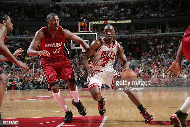Ben Gordon of the Chicago Bulls works the ball around James Posey of the Miami Heat in the third quarter of game six of the Eastern Conference...