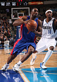 Ben Gordon of the Detroit Pistons drives against Jason Terry of the Dallas Mavericks during a game at the American Airlines Center on January 5 2010...