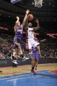Ben Gordon of the Detroit Pistons goes up for a shot attempt against Goran Dragic of the Phoenix Suns in a game at the Palace of Auburn Hills on...