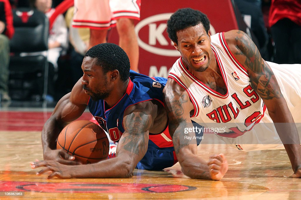 Ben Gordon of the Detroit Pistons grabs a loose ball ahead of James Johnson of the Chicago Bulls during the NBA game on October 30 2010 at the United...