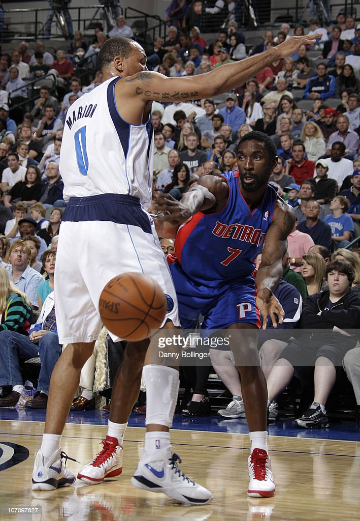 Ben Gordon #7 of the Detroit Pistons passes to a teammate against Shawn Marion #0 of the Dallas Mavericks during a game on November 23, 2010 at the American Airlines Center in Dallas, Texas.