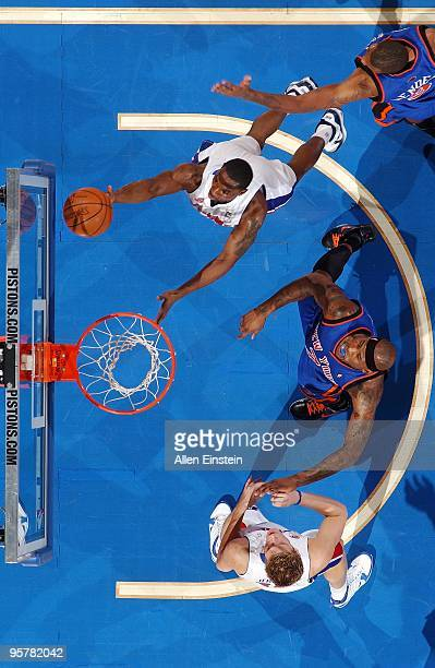 Ben Gordon of the Detroit Pistons shoots a layup against Jonathan Bender and Al Harrington of the New York Knicks during the game at the Palace of...