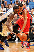 Ben Gordon of the Orlando Magic and Otto Porter Jr #22 of the Washington Wizards go for the ball on October 30 2014 at Amway Center in Orlando...