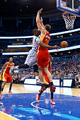 Ben Gordon of the Orlando Magic makes a pass against Donatas Motiejunas of the Houston Rockets during the game at Amway Center on January 14 2015 in...