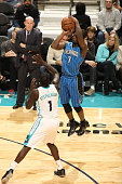 Ben Gordon of the Orlando Magic shoots against Lance Stephenson of the Charlotte Hornets during the game at the Time Warner Cable Arena on November...