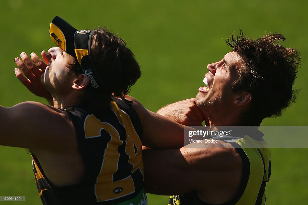 Ben Griffiths of the Tigers (L) and Alex Rance of the Tigers compete for the ball during the Richmond Tigers AFL intra-club match at Punt Road Oval on February 12, 2016 in Melbourne, Australia.
