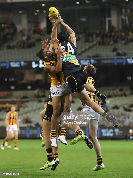 Ben Griffiths of the Tigers is challenged by Josh Gibson of the Hawks during the round seven AFL match between the Richmond Tigers and the Hawthorn...