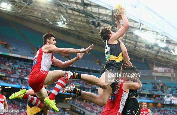 Ben Griffiths of the Tigers marks during the round 23 AFL match between the Sydney Swans and the Richmond Tigers at ANZ Stadium on August 30 2014 in...