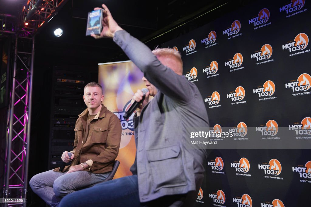 Ben Haggerty aka Macklemore (L) gives an interview to on air personality Eric Powers at Hot 103.7 as his new solo album 'Gemini' is released on September 22, 2017 in Seattle, Washington.