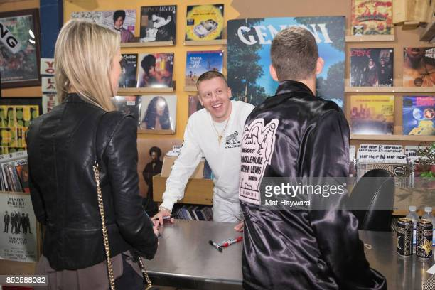 Ben Haggerty aka Macklemore greets a fan during a listening party for his newly released solo album 'Gemini' at Easy Street Records on September 22...