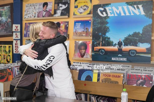 Ben Haggerty aka Macklemore hugs a fan during a listening party for his newly released solo album 'Gemini' at Easy Street Records on September 22...