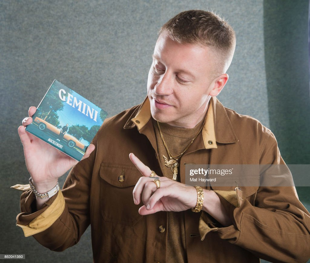 Ben Haggerty aka Macklemore poses for a portrait with a copy his new album 'Gemini' at Hot 103.7 on September 22, 2017 in Seattle, Washington.