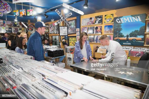 Ben Haggerty aka Macklemore signs an autograph during a listening party for his newly released solo album 'Gemini' at Easy Street Records on...